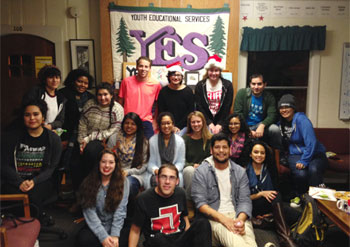 The volunteers of Youth Mentoring Program hanging out together at the YES House.