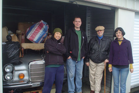 Volunteers help to move storage contents for a resident's elderly mother.
