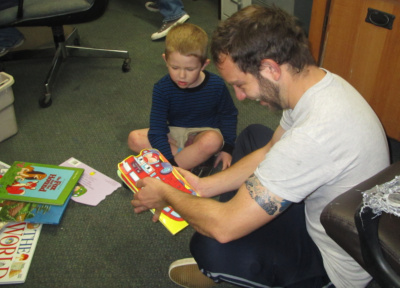 Volunteer shares picture book stories
